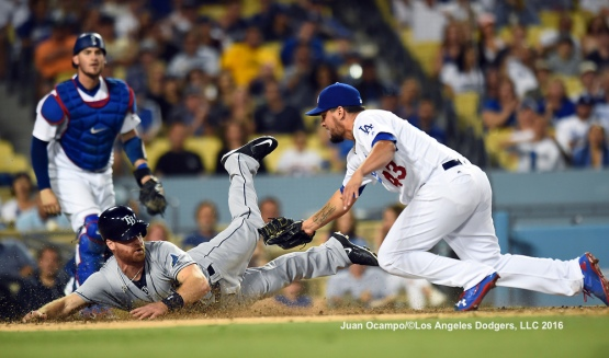 The Rays' Logan Forsythe slides into home safely under the tag of the Dodgers' Luis Avilan in the eighth inning.