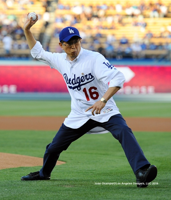 Akira Chiba, the new Consul General of Japan in Los Angeles, throws out the ceremonial first pitch.