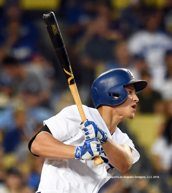 Corey Seager connects for an RBI single in the third inning.