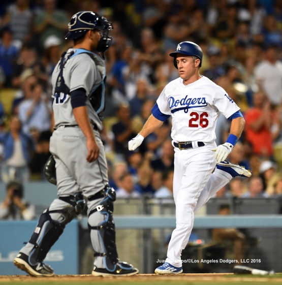 Chase Utley scores in the third inning.