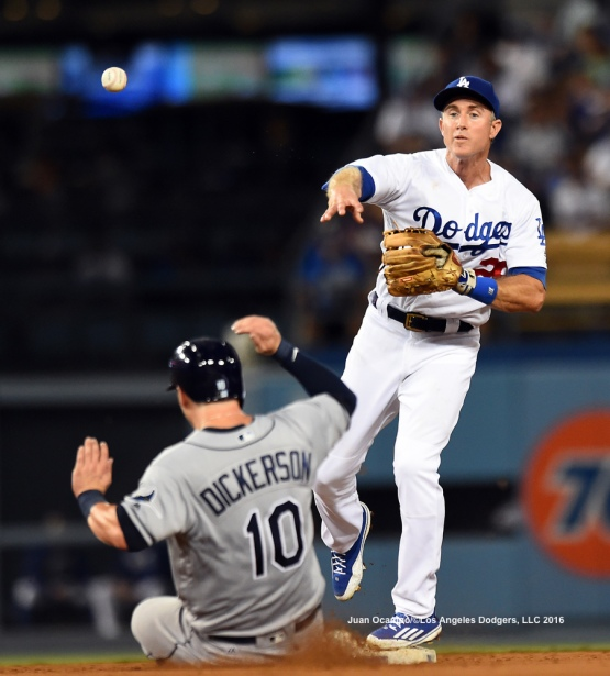 Chase Utley forces out the Rays' Corey Dickerson at second base to start the double-play in the fourth inning.