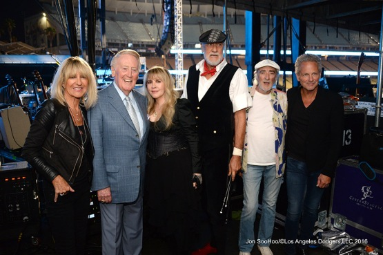 Fleetwood Mac poses with Los Angeles Dodgers Hall of Fame Broadcaster Vin Scully during the Dodgers Foundation Blue Diamond Gala Thursday, July 28,2016 at Dodger Stadium in Los Angeles,California. Mandatory photo credit must read:  Jon SooHoo/©Los Angeles Dodgers,LLC 2016