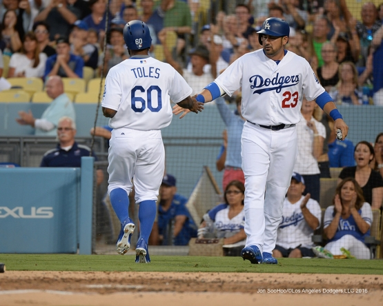 Los Angeles Dodgers Andrew Toles and Adrian Gonzalez score during game against the Arizona Diamondbacks Friday, July 29,2016 at Dodger Stadium in Los Angeles,California. Photo by Jon SooHoo/©Los Angeles Dodgers,LLC 2016