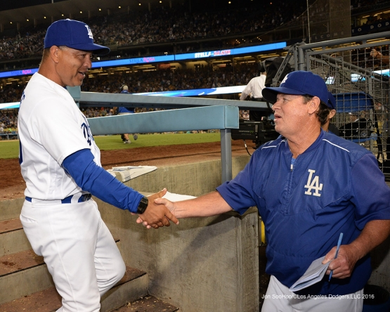 Los Angeles Dodgers Dave Roberts and Rick Honeycutt after win  against the Arizona Diamondbacks Friday, July 29,2016 at Dodger Stadium in Los Angeles,California. Photo by Jon SooHoo/©Los Angeles Dodgers,LLC 2016