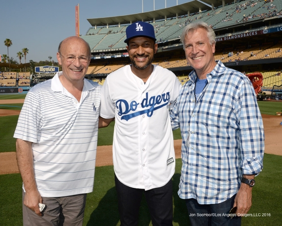 Stan Kasten and Mark Walter pose with comedian Keegan-Michael Key pose prior to game against the Arizona Diamondbacks Friday, July 30,2016 at Dodger Stadium in Los Angeles,California. Photo by Jon SooHoo/©Los Angeles Dodgers,LLC 2016