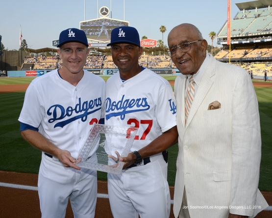 Chase Utley receives awards from George Lombard and Don Newcombe prior to game against the Arizona Diamondbacks Friday, July 30,2016 at Dodger Stadium in Los Angeles,California. Photo by Jon SooHoo/©Los Angeles Dodgers,LLC 2016