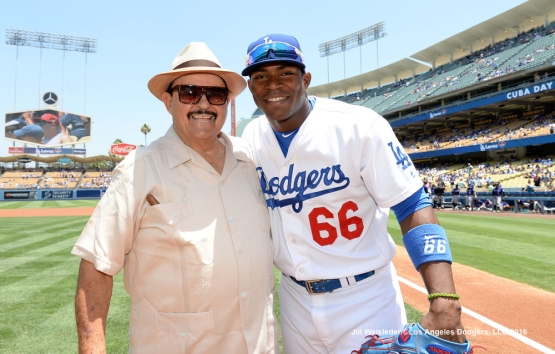 Los Angeles Dodgers scout Mike Brito and Yasiel Puig pose for a photo during pre-game festivities celebrating Cuban Heritage Day at Dodger Stadium. Jill Weisleder/Dodgers