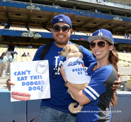 Dodger fans pose with their Dodger dog during the pup parade. Jill Weisleder/LA Dodgers