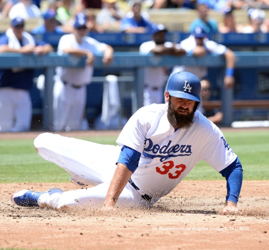 Scott Van Slyke slides home safely. Jill Weisleder/LA Dodgers