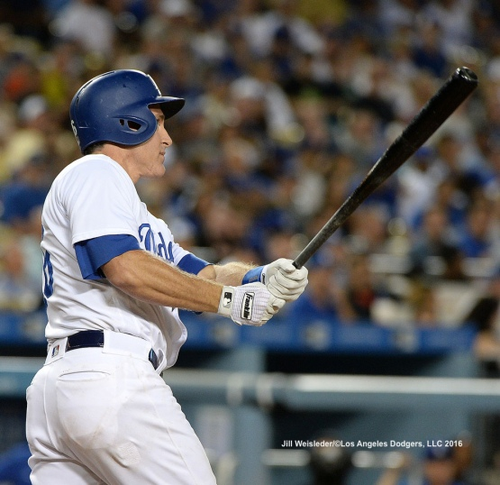 Chase Utley watches his ball take flight for a homerun. Jill Weisleder/Dodgers