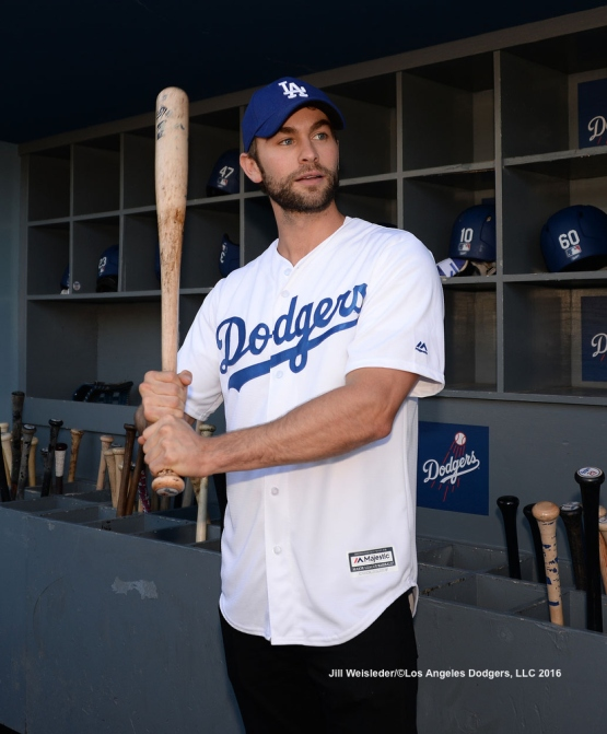 Actor Chase Crawford takes a batting stance in the Dodger dugout prior to the start of the game. Jill Weisleder/LA Dodgers