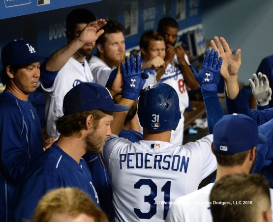 Joc Pederson celebrates in the dugout after belting a solo home run in the ninth inning. Jill Weisleder/Dodgers