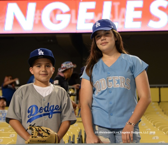 Young Dodger fans smile as they wait patiently for a ball. Jill Weisleder/Dodgers