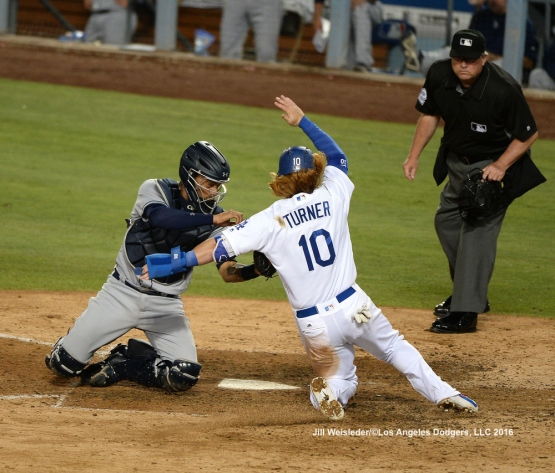 Justin Turner is tagged out at home plate by Padres catcher Christain Bethancourt. Jill Weisleder/LA Dodgers