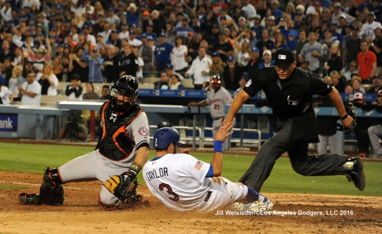 Chris Taylor slides safely home under the glove of Baltimore Orioles catcher Matt Wieters. Jill Weisleder/Dodgers