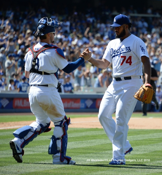 Yasmani Grandal congratulates Kenley Jansen after picking up his 27th save this season.  The Dodgers win 3-1 against the Padres. Jill Weisleder/LA Dodgers