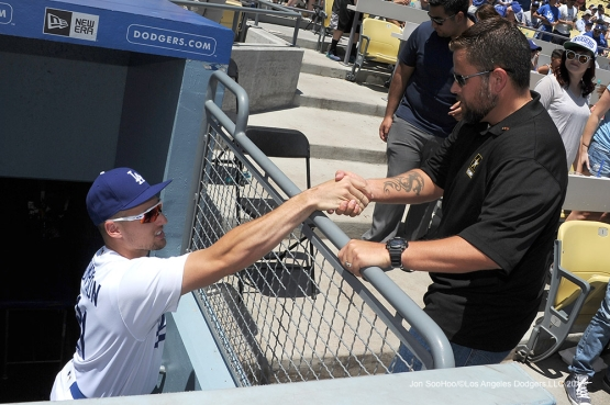 Military Hero of the Game, U.S. Army Sergeant, David Harman is greeted by Trayce Thompson during game against the Tampa Bay Rays Wednesday, July 27,2016 at Dodger Stadium in Los Angeles,California. Photo by Jon SooHoo©Los Angeles Dodgers,LLC 2016