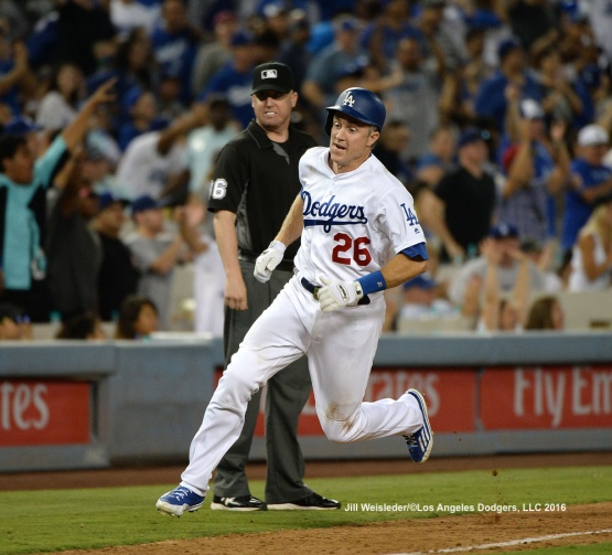 Chase Utley rounds third base to come in to score. Jill Weisleder/Dodgers