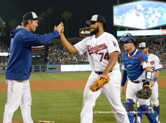 Kenley Jansen celebrates with Clayton Kershaw on the mound.  The Dodgers beat the Baltimore Orioles 7-5. Jill Weisleder/Dodgers