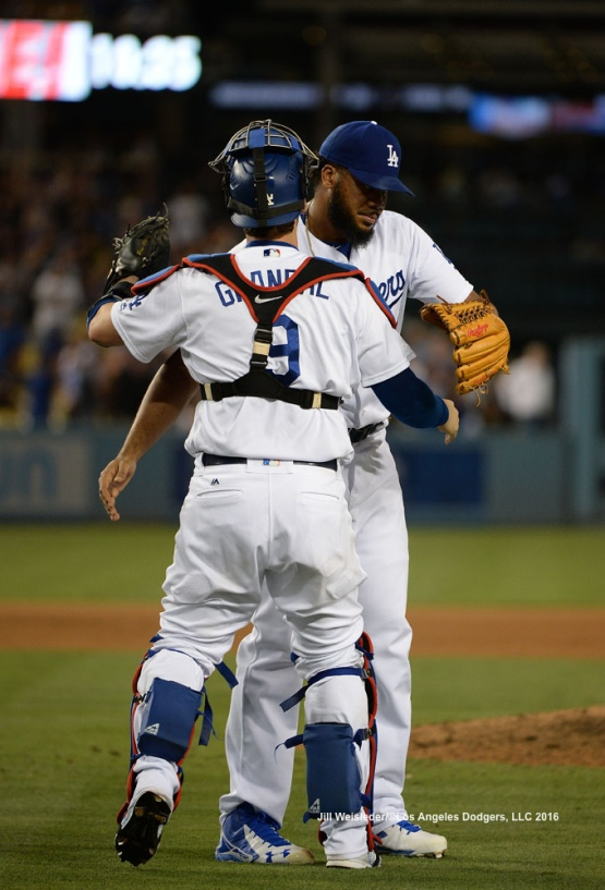 Kenley Jansen and Yasmani Grandal celebrate a win against the Arizona Diamondbacks. Jill Weisleder/Dodgers