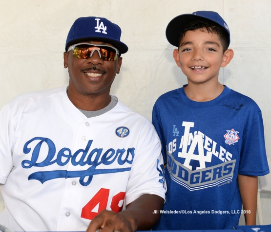 Former Dodger Dennis Powell and a young Dodger fan poses for a photo at Viva Los Dodgers. Jill Weisleder/LA Dodgers