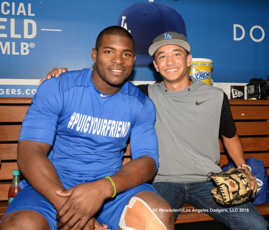 Yasiel Puig and Cole Roberts pose for a photo in the dugout after the Dodger and Orioles game. Jill Weisleder/Dodgers