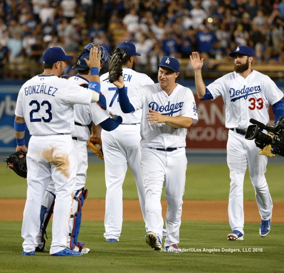 The Dodgers celebrate a 9-7 win against the Arizona Diamondbacks. Jill Weisleder/Dodgers