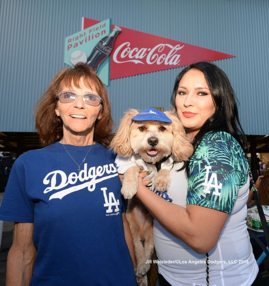Dodger fans enjoy themselves in the right-field pavilion section with their dog. Jill Weisleder/LA Dodgers