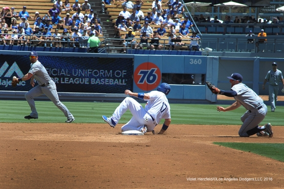 Los Angeles Dodgers A.J.Ellis steals his first career stolen base during game against the Tampa Bay Rays Wednesday, July 27,2016 at Dodger Stadium in Los Angeles,California. Photo by Violet Herzfeld