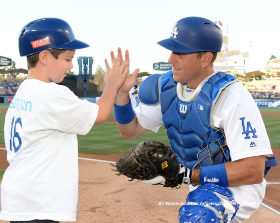 Catcher A.J. Ellis high-fives a young participant during Kids Take the Field. Jill Weisleder/LA Dodgers