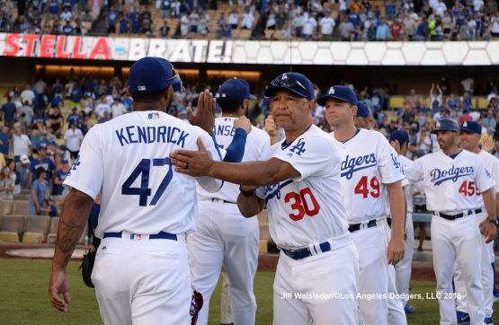 Manager Dave Roberts congratulates Howie Kendrick after the game. Jill Weisleder/LA Dodgers