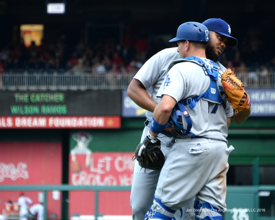 Los Angeles Dodgers Kenley Jansen and A.J.Ellis hug after win  against the Washington Nationals Thursday, July 21, 2016 at Nationals Park in Washington,DC. Photo by Jon SooHoo/©Los Angeles Dodgers,LLC 2016