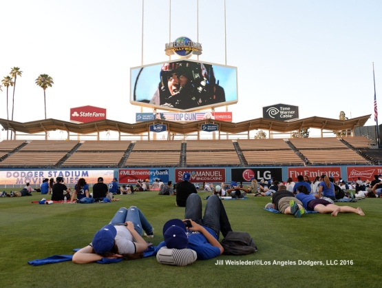 "Fans relax and enjoy themselves for the post game movie ""Top Gun"", presented by Fandango.  Jill Weisleder/LA Dodgers"
