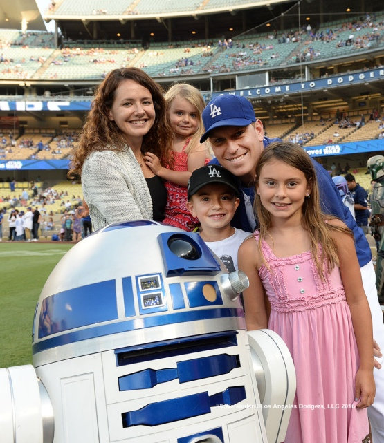 A.J. and Cindy Ellis pose with Star Wars character R2-D2. Jill Weisleder/Dodgers