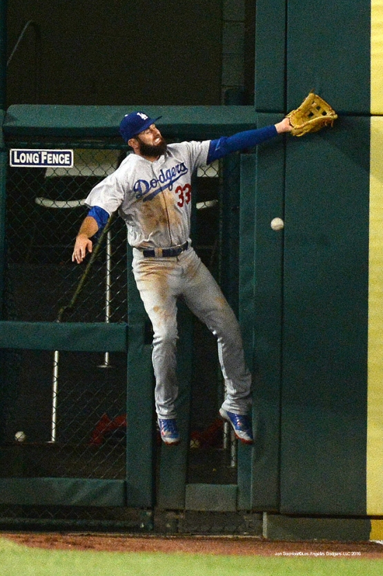 Los Angeles Dodgers Scott Van Slyke can't get to ball during game against the Washington Nationals Wednesday, July 20, 2016 at Nationals Park in Washington,DC. Photo by Jon SooHoo/©Los Angeles Dodgers,LLC 2016