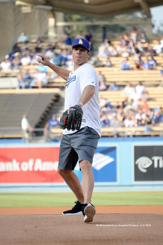 Los Angeles Lakers coach Luke Walton throws the ceremonial first pitch prior to the start of the game. Jill Weisleder/Dodgers