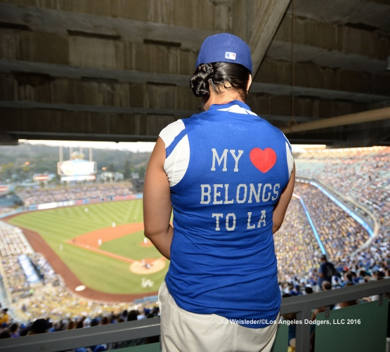 A proud Dodger fan shows her support while watching the game from the stands. Jill Weisleder/LA Dodgers