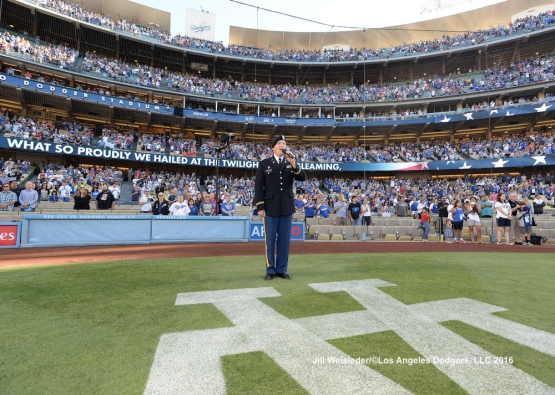 U.S. Army Chief Warrant Officer Jeff Smith of Los Angeles sings the National Anthem during pre-game festivities. Jill Weisleder/Dodgers