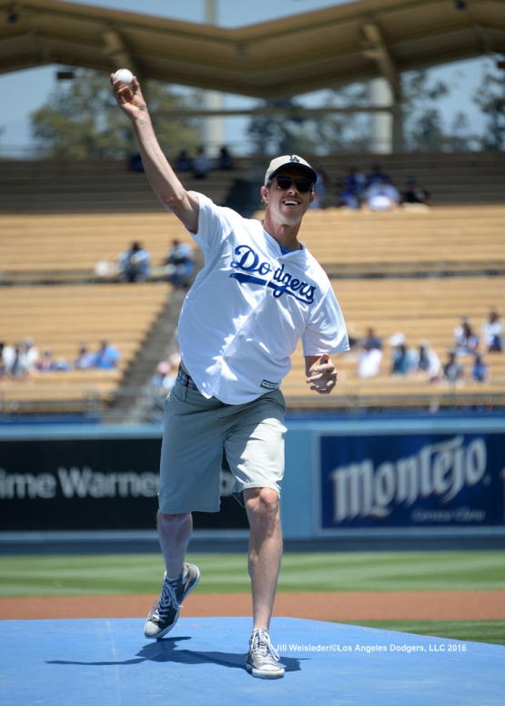 Professional tennis player Sam Querrey throws the ceremonial first pitch prior to the game. Jill Weisleder/LA Dodgers