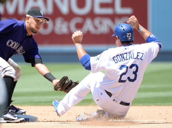 Adrian Gonzalez is tagged out by Colorado Rockies Cristhian Adames. Jill Weisleder/Dodgers