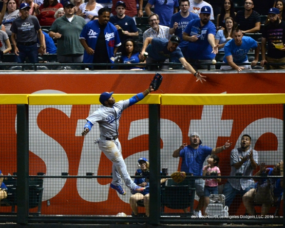 Los Angeles Dodgers Yasiel Puig can't get to home run ball during game against the Arizona Diamondbacks Friday, July 15, 2016 at Chase Field in Phoenix, Arizona. Photo by Jon SooHoo/©Los Angeles Dodgers,LLC 2016