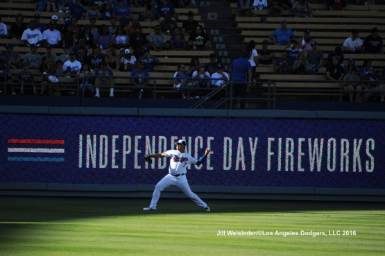Starting pitcher Julio Urias warms up in the outfield prior to the start of the game. Jill Weisleder/Dodgers