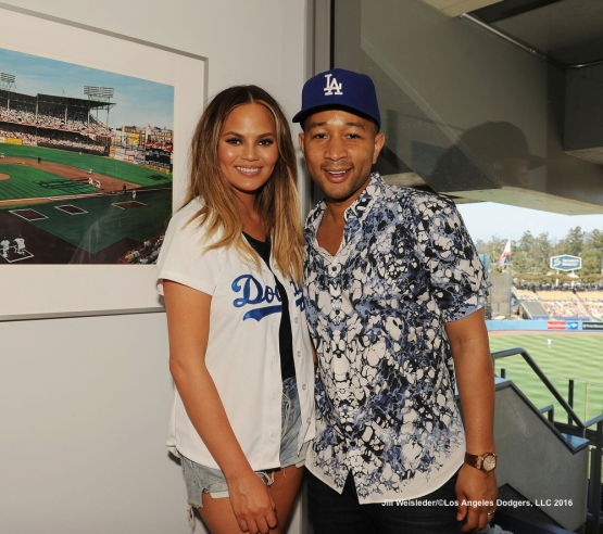 Chrissy Teigen and John Legend take in the Dodger game. Jill Weisleder/Dodgers