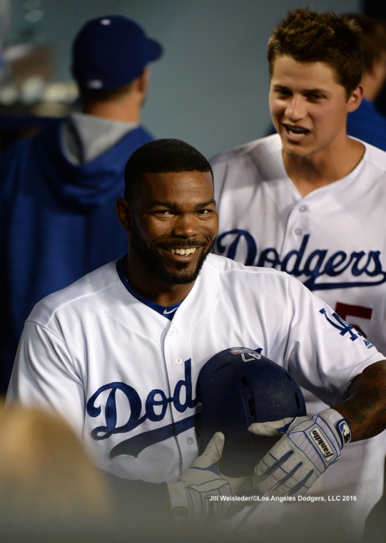 Howie Kendrick smiles in the dugout after getting his second homer against the Padres. Jill Weisleder/LA Dodgers