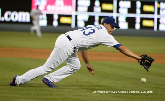 Luis Avilan reaches attempts to make a play at first base. Jill Weisleder/Dodgers