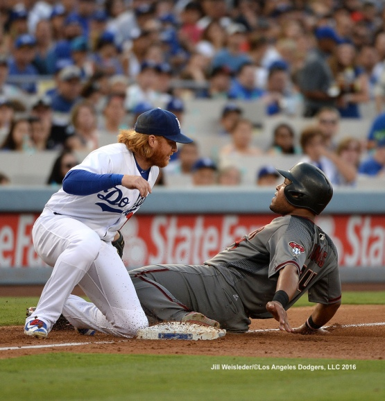 Justin Turner applies the tag to get out Arizona Diamondbacks' Yasmany Tomas. Jill Weisleder/Dodgers