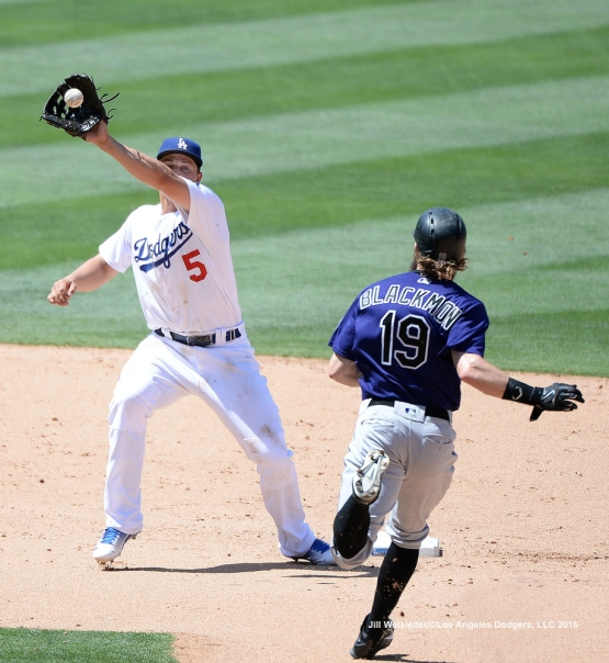 Corey Seager makes the play to get out Colorado Rockies Charlie Blackmon at second base. Jill Weisleder/Dodgers