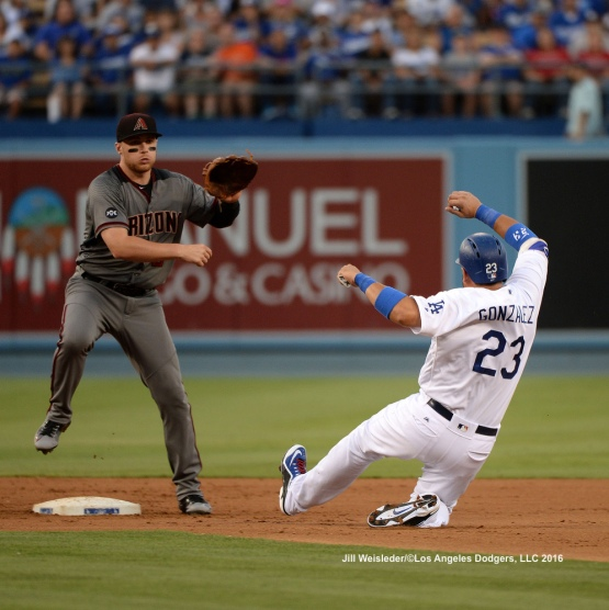 Arizona Diamondbacks' Brandon Drury gets out Adrian Gonzalez at second base. Jill Weisleder/Dodgers