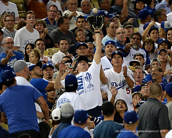Great Los Angeles Dodger fan makes a great catch during game against the San Francisco Giants Wednesday, August 24, 2016 at Dodger Stadium in Los Angeles,California. Photo by Jon SooHoo/©Los Angeles Dodgers,LLC 2016