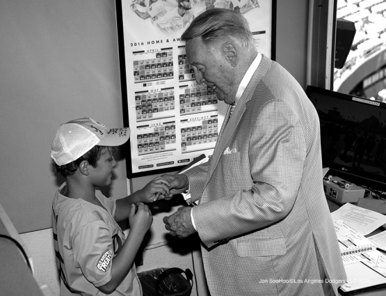 Vin Scully signs for fan prior to game against the Chicago Cubs Sunday, August 28, 2016 at Dodger Stadium in Los Angeles,California. Photo by Jon SooHoo/©Los Angeles Dodgers,LLC 2016